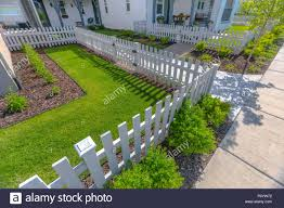 Front Yard With Lawns And Shrubs With White Fence Stock Photo Alamy