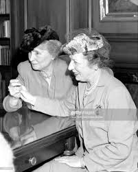 Helen Keller, assisted by her secretary Polly Thompson, during ...