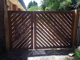 Merbau Double Gates With 45 Degree Angle Running Merbau Fence Design House Gate Design Double Gate