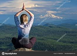 outdoor yoga woman tating by the view of volcano mount hood in oregon the dalles portland or united states of america photo by marinapoushkina