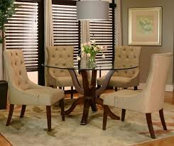 enhance your dining room with the addition of an area rug from simple to bold the colors and shape you choose are up to you and your home s decorative