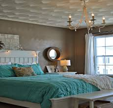 Brown and turquoise bedroom with painted ceiling