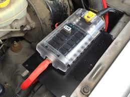 installing an auxiliary fuse block in an xj com our new fuse block freshly installed juiced up and already providing power to