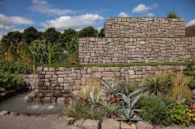 a retaining wall s function is not just to stop soil but also to shape the land