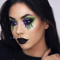 glam with a touch of gore makeup artist diana maria slays purple and green slime eyes if you were looking for an excuse to rock black lipstick