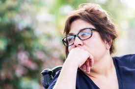woman outside looking contemplative considering estrogen and weight gain
