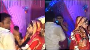 Girl turns and slaps bride