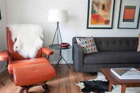 tweed living room ideas living room midcentury with cowhide rug on upholstery orange leather stool