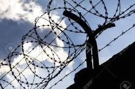 barbed wire fence prison. Dramatic Clouds Behind Barbed Wire Fence On A Prison Wall Stock Photo - 56370261 Y
