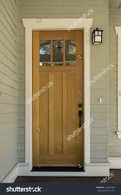 Natural Wood Front Door Surrounding White Stock Photo - Hardwood exterior doors and frames