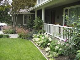 White Ranch Style House Design With Wonderful Landscaping Ideas Using White  Flowers And Green Grasses