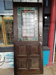 old antique vintage front entry stained glass or wood doors