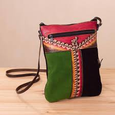 llama themed multicolored leather sling from peru llama in the mountains