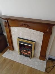 now sold traditional fireplace with dark wood surround and electric fire