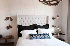 painted brick interior bedroom transitional with white tufted