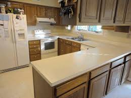 kitchens with corian countertops counter height island table wet bar with sink and refrigerator cabinet paint ideas corian laminate countertops