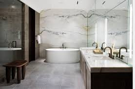 View in gallery Modern bathroom with marble walls and countertop