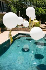 white balloons over the pool for an airy feel
