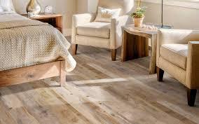 a bedroom featuring plank vinyl flooring that looks like real wood