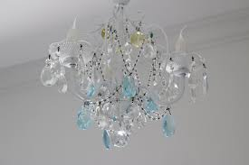 image of ceiling fan with chandelier light kit
