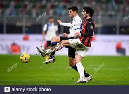 MILAN, ITALY - January 23, 2021: Matteo Pessina of Atalanta BC is  challenged by Sandro Tonali of AC Milan during the Serie A football match  between AC Milan and Atalanta BC. (Photo