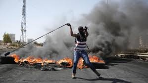Image result for palestinians rioting and using slingshots
