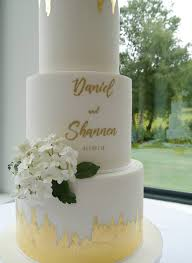 Contemporary White Wedding Cake With Hand Painted Calligraphy Gold