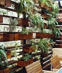 outdoor plant wall movable wooden planters on a plant wall house upper west side used on their patio this garden makes the most of their space outdoor wall