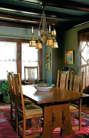 arts and crafts dining room prairie style house dining room a reproduction style fixture hangs over the dining room table arts and crafts dining table for