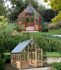 wooden greenhouse covered in tempered glass by greenhousemega com