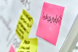 Word Independent Written On Pink And Yellow Paper Stickers Attached