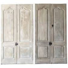two pairs of matching antique cabinet doors with reclaimed hardware for