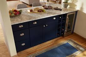 navy base cabinetry cup pulls and knobs with cambria countertops minifridge and wine cubbies