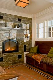 Reading nook with masonry heater and encaustic tile floor rustic-living-room