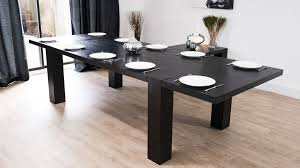 large black extending dining table