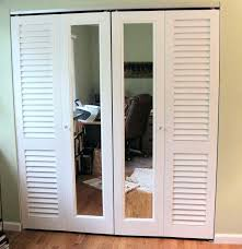 a combination of plantation louvered doorirror are used to make up these closet bifold solid louvered bifold closet doors