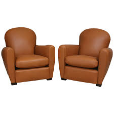 pair of french leather club chairs with velvet cushions for at 1stdibs