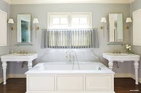 kohler tea for two bubblemassage air bath tub flanked by waterworks belle epoque two leg single console packaged