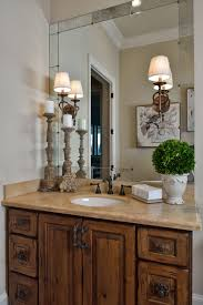 tuscan style lighting. Tuscan Style Bathroom, Old World Feel, Antiqued Mirror, Travertine, Rustic Hardware, Mirror Mounted Sconces Photography By: Miro Dvorscak Lighting