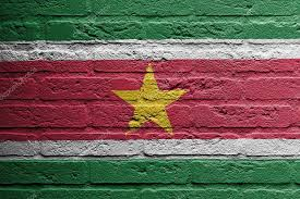 brick wall with a painting of a flag isolated suriname photo by michaklootwijk