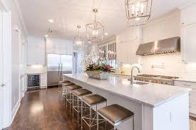 Good Stunning Kitchen Features An Extra Long Center Island Topped With Marble  Fitted With A Curved Prep Sink, Facing The Cooktop, And Satin Nickel Faucet  Lined ...
