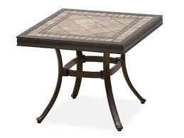 traditional small space patio with square stone top end table