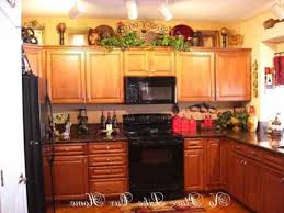 decorating above kitchen cabinets tuscan style deductour decorate