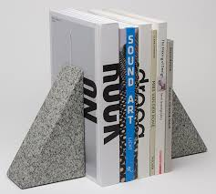 These granite bookends from Field, designed by Daniel Emma, aren't cheap   but they should certainly be effective, and they are lovely.