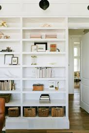 home office bookshelf. A Wall Of Built-in Bookshelves Elegantly Displays Books, Accessories And Wicker Storage Baskets In This Home Office Design By House Jade Interiors. Bookshelf E