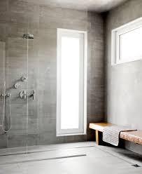 long teak bench in gray walk in shower