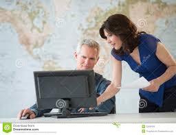 office world desks. Business People Working On Computer At Office Desk World Desks