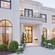 A beautiful elegant exterior! Black mullions and doors add great ...