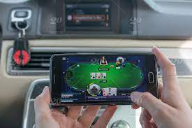 Girl in the car playing poker on the mobile phone, online, poker, gamble,  internet, technology, game, leisure, casino, gambling, man, addiction, bet,  luck, green, computer, success, risk, application, playing, table, app,  hands,