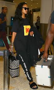just stopping by rihanna flew into australia on tuesday as she continued her whirlwind promotional